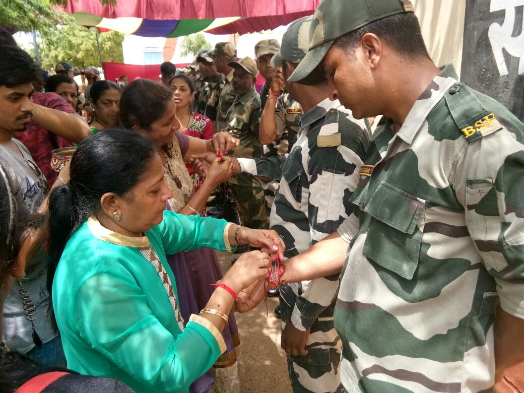TIEING RAKHI TO B.S.F. JAWANS AT KUTCH BORDER