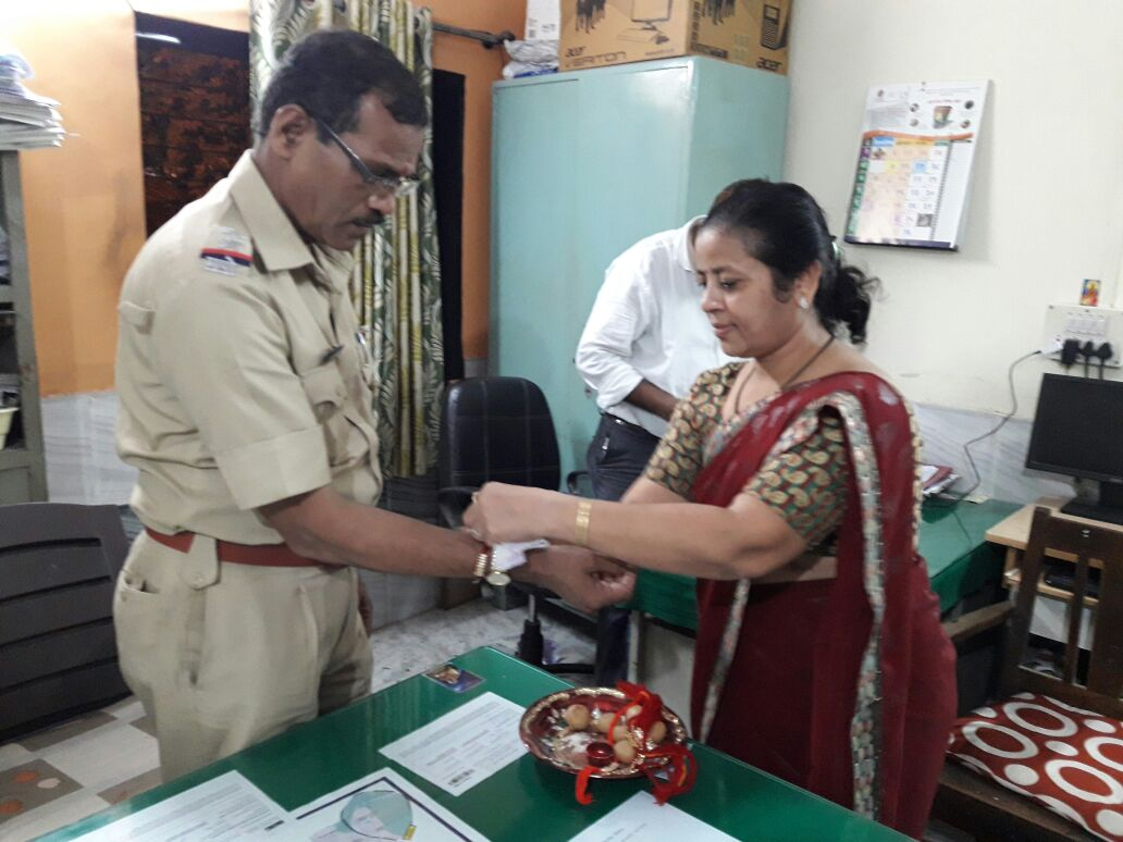 TIEING RAKHI TO POLICE STATION INCHARGE AT DOMBIVALI SAKHA